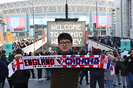 Fan posing with England v Croatia scarf in front of Webley Stadium during the UEFA Nations League match between England and Croatia at Wembley Stadium, London, England on 18 November 2018.
