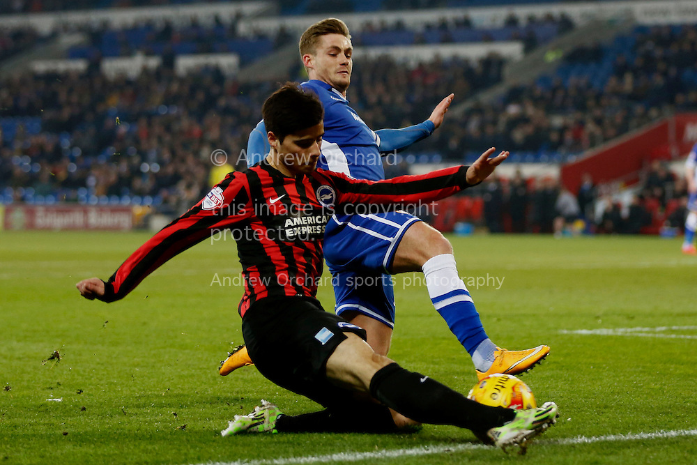 Joao Teixeira of Brighton attempts to cross under a challenge from Stuart O'Keefe of Cardiff City.<br /> Skybet football league championship match, Cardiff City v Brighton & Hove Albion at the Cardiff city Stadium in Cardiff, South Wales on Tuesday 10th Feb 2015.<br /> pic by Mark Hawkins, Andrew Orchard sports photography.