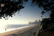People walking on sand at Butterfly Beach, Santa Barbara, California