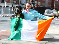Libby McEniff, 11, from Dublin with her dog, Scobby at the centenary Easter Rising Parade at Cuffe Street in Dublin. Picture credit; Damien Eagers 27/3/2016