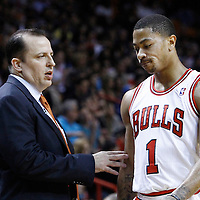 29 January 2012:  Chicago Bulls point guard Derrick Rose (1) looks dejected as he listens to Chicago Bulls head coach Tom Thibodeau during the Miami Heat game against the Chicago Bulls at the AmericanAirlines Arena, Miami, Florida, USA.