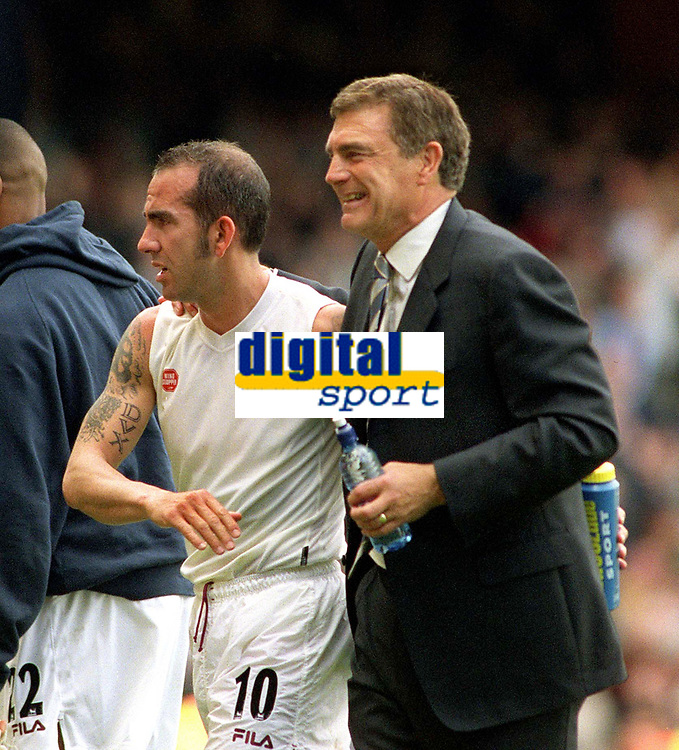 Paolo Di Canio (West Ham) is congratulated by caretaker Manager,Trevor Brooking at the end of the match. West Ham United  v Chelsea. Upton Park. 3/5/2003. Credit : Colorsport/Andrew Cowie.