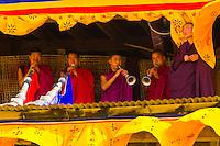 Monks playing horns,  Paro Tsechu (festival), Paro, Bhutan