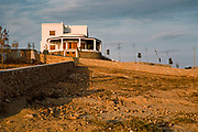 Newly built modern villa home on hillside above Calvi, Corsica, France in late 1950s