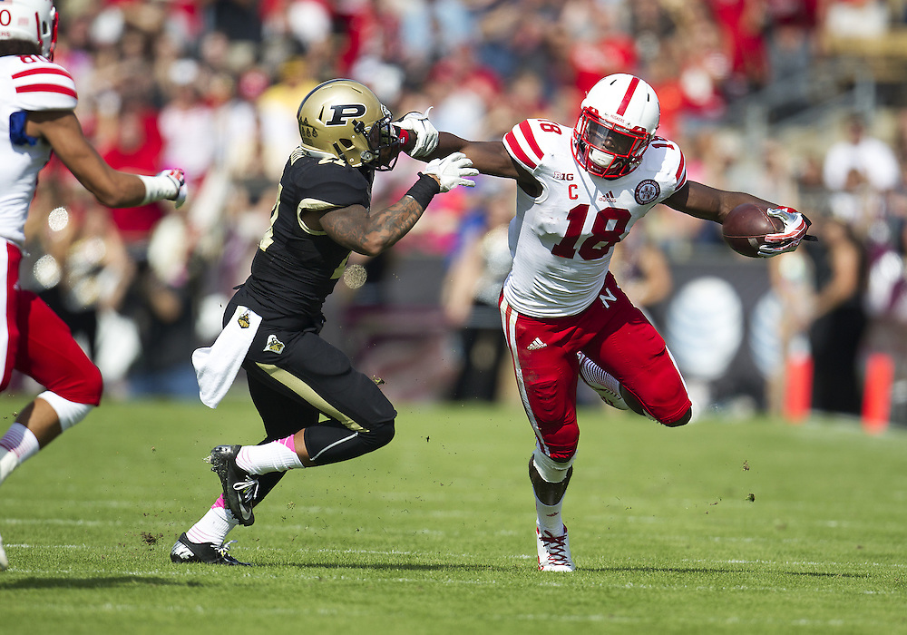 October 12, 2013:  Nebraska wide receiver Quincy Enunwa (18) runs for yardage as Purdue cornerback Ricardo Allen (21) attempts to make the tackle during NCAA Football game action between the Nebraska Cornhuskers and the Purdue Boilermakers at Ross-Ade Stadium in West Lafayette, Indiana.  Nebraska defeated Purdue 44-7.