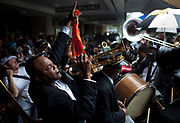James Andrews plays trumpet during a jazz funeral for Lionel Batiste in New Orleans, July 20, 2012. Batiste, who died July 8, was a jazz legend in the city and bass drummer and assistant grand marshal of the Treme Brass Band. (Andrew Stanfill/Special to the Sun)