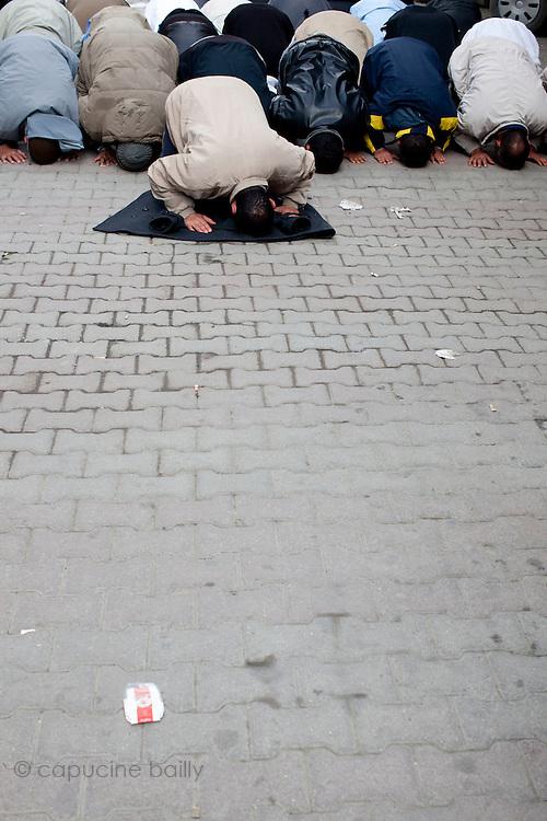 Tunis, Tunisia. January 26th 2011.Men pray in a street near the Casbah......