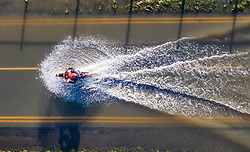 © Licensed to London News Pictures. 23/12/2019. Yalding, UK. A motorcyclist makes his way along a flooded road near Yalding in Kent. River levels are slowly beginning to drop after days of heavy rain in the south. Photo credit: Peter Macdiarmid/LNP
