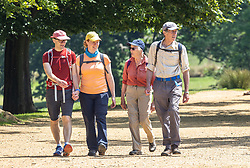 Licensed to London News Pictures. 30/05/2021. London, UK. Hikers head out in the warm sunshine for a Sunday walk in Richmond Park, southwest London this afternoon. The Met Office have forecast warm weather and sunshine for the South East and London over the Bank Holiday weekend with temperatures predicted to hit up to 24c for Bank Holiday Monday. Photo credit: Alex Lentati/LNP
