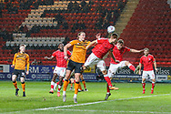 Charlton Athletic defender Jason Pearce (6) heads the ball out of danger during the EFL Sky Bet Championship match between Charlton Athletic and Hull City at The Valley, London, England on 13 December 2019.