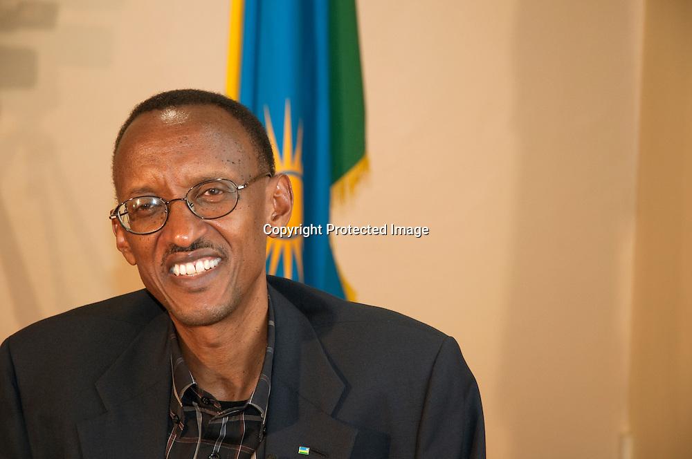 Rwandan President Paul Kagame with the Rwandan flag at his office in the Rwandan capital Kigali.