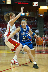 04 February 2006: Melanie Boeglin targets a path past Kristi Cirone. The Indiana State Sycamores shook the Illinois State Redbirds from the nest with a 75-71 Victory.  There were 3,581 fans on hand, making the audience the  2nd largest women's basketball crowd ever in Redbird Arena on Illinois State University campus in Normal Illinois.