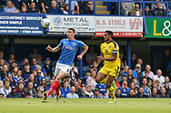 Portsmouth Forward, Oliver Hawkins (9) and Oxford United Defender, Curtis Nelson (5) during the EFL Sky Bet League 1 match between Portsmouth and Oxford United at Fratton Park, Portsmouth, England on 18 August 2018.
