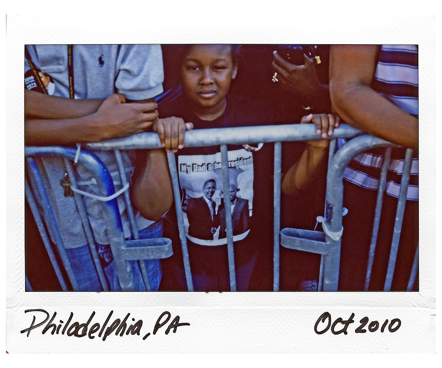 A supporter of U.S. President Barack Obama is seen behind a barricade at a rally at Vernon Park in Philadelphia, October 10, 2010.