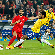 Turkey's Mehmet Topal (L) and Brazil's Luiz Adriano (C) Oscar (R) during their a international friendly soccer match Turkey betwen Brazil at Sukru Saracoglu Arena in istanbul November 12, 2014. Photo by Aykut AKICI/TURKPIX