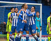 Brighton striker Bobby Zamora  celebrates with Brighton striker Anthony Knockaert after opening the scoring during the Sky Bet Championship match between Brighton and Hove Albion and Huddersfield Town at the American Express Community Stadium, Brighton and Hove, England on 23 January 2016. Photo by Bennett Dean.