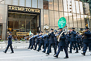 The New York City Police Department band marching in front of Trump Tower during the St. Patrick's Day Parade in New York City.