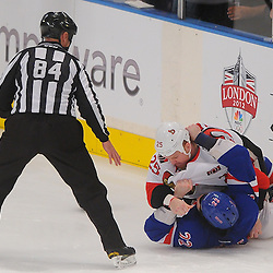 April 14, 2012: Ottawa Senators right wing Chris Neil (25) wrestles New York Rangers center Brian Boyle (22) down to the ice in a fight during the first period of game 2 of the NHL Eastern Conference Quarter-finals between the Ottawa Senators and New York Rangers at Madison Square Garden in New York, N.Y.