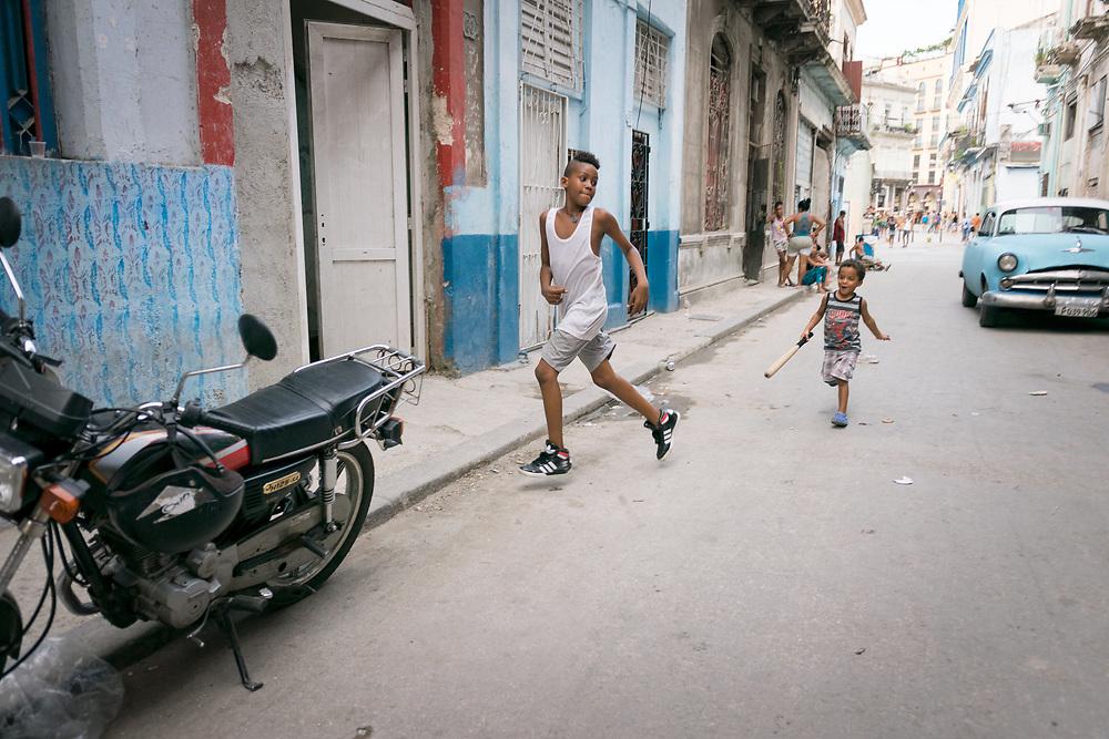 9 September, Havana, Cuba: Children play on the street outside their home in Havana.