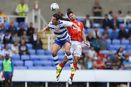 Yann Kermorgant of Reading and Christopher Schindler of Huddersfield Town both jump to head the ball. EFL Skybet  championship match, Reading  v Huddersfield Town at The Madejski Stadium in Reading, Berkshire on Saturday 24th September 2016.<br /> pic by John Patrick Fletcher, Andrew Orchard sports photography.