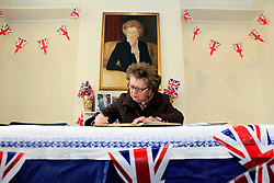 © Licensed to London News Pictures 10/04/2013.Mrs Rita Visconti, from Eastbourne, but a former resident of Finchley, signs the condolence book, following the death of Margaret Thatcher, at Finchley Conservatives Association in north London, ..London, UK.Photo credit: Anna Branthwaite