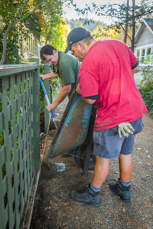 """""""I work for ten different wineries...I do all sorts of projects...including fence repairs.  I do something new every day.""""  Mike McCay changes fence posts with his assistant, Craig Thompson, at a winery property on Cedar Street in Calistoga"""