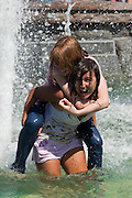 Moscow, Russia, 25/06/2010..Teenage girls in fountains next to the Kremlin and Red Square during a heatwave that has seen temperatures of up to 37C, a record for the month of June.