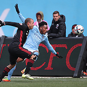 NEW YORK, NEW YORK - March 12:  Rodney Wallace #23 of New York City FC is challenged by Nick DeLeon #14 of D.C. United during the NYCFC Vs D.C. United regular season MLS game at Yankee Stadium on March 12, 2017 in New York City. (Photo by Tim Clayton/Corbis via Getty Images)