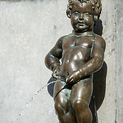 The Mannekin Pis, a small bronze fountain sculpture of a naked little boy urinating into the fountain. Installed in about 1619 by Hiëronymus Duquesnoy the Elder, it is a cultural symbol of the city of Brussels and a famous tourism landmark. With copyspace.