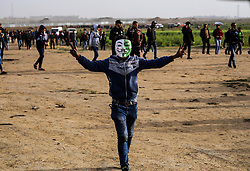 March 30, 2019 - Gaza City, The Gaza Strip, Palestine - Palestinian protestors wave Palestinian flags and shout slogans as they march towards the Israel-Gaza border, on the first anniversary of the Great March of Return protests. (Credit Image: © Mahmoud Issa/Quds Net News via ZUMA Wire)