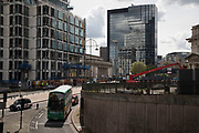 Buses and infrastructure and the contruction continues in the redevelopment of Birmingham city centre, United Kingdom.