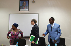 August 10, 2017 - Dar es Salaam, Tanzania - Philanthropist BILL GATES announced a 5 million investment to help digitize Tanzania's health information systems and improve health data in the country. Gates congratulated members of the government of Tanzania on leading a drive to incorporate digital health and data into their policy framework. Pictured: Dr. UMMY MWALIMU, Minister of Health (left), and the honorable GEORGE SIMBACHAWENE, Minister of President's Office, who just gave Gates a green document denoting the initiative's launch. (Credit Image: © Ric Francis via ZUMA Wire)