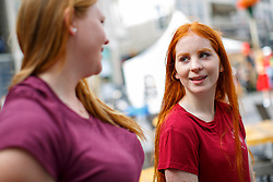 © Licensed to London News Pictures. 04/09/2016. Breda, The Netherlands. Alina Gerike and Emily Neumann attend The Redhead Days festival as thousands of redheads fill a Dutch city Breda to celebrate International Redhead Day event in The Netherlands on Sunday, 4 September 2016. Every year natural redheads from more than 80 countries come together at 'Roodharigendag' annual weekend long festival to celebrate their ginger genes. The event also holds the world record for the largest number of natural redheads being in one place. Photo credit: Tolga Akmen/LNP