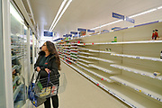 March 20, 2020, London, England, United Kingdom: Customers are seen shopping for items meanwhile groceries, meat, as well as hygienic shelves, go empty very fast at most supermarkets in London. For most people, the new coronavirus causes only mild or moderate symptoms, such as fever and cough. For some, especially older adults and people with existing health problems, it can cause more severe illness, including pneumonia. .Coronavirus claimed 144 lives to date of the British people, with 3,269 confirmed positive, as reported by authorities on Friday, March 20, 2020. (Credit Image: © Vedat Xhymshiti/ZUMA Wire)