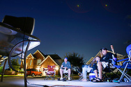 KEVIN BARTRAM/The Daily News<br /> D.J. Alvarez, right, watches Game 2 of the World Series on a television set up in front of his home in League City on Sunday, Oct. 23, 2005. Alvarez and his neighbors gathered in the cul de sac in front of their homes to watch the Astros playoff games and continue the tradition during the World Series.