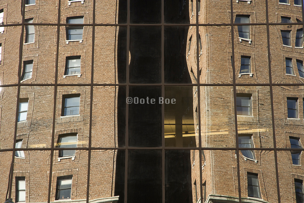 old building reflecting in a modern building