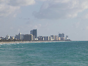 view of hotels at Miami Beach Florida in early morning sunshine with the Atlantic Ocean seen from South Point