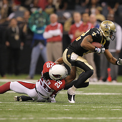 16 January 2010:  New Orleans Saints wide receiver Marques Colston (12) is tackled by Arizona Cardinals cornerback Greg Toler (28) during a 45-14 win by the New Orleans Saints over the Arizona Cardinals in a 2010 NFC Divisional Playoff game at the Louisiana Superdome in New Orleans, Louisiana.