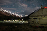 The sheep and goat herd lit by flashlight. Evening at Nemat Ulla and Woolook Bu's yurt..Daily life at the Khan (chief) summer camp of Kara Jylga...Trekking through the high altitude plateau of the Little Pamir mountains (average 4200 meters) , where the Afghan Kyrgyz community live all year, on the borders of China, Tajikistan and Pakistan.