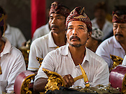 13 JULY 2016 - UBUD, BALI, INDONESIA: A gamelan orchestra performs during the mass cremation in Ubud. Local people in Ubud exhumed the remains of family members and burned their remains in a mass cremation ceremony Wednesday. Almost 100 people will be cremated and laid to rest in the largest mass cremation in Bali in years this week. Most of the people on Bali are Hindus. Traditional cremations in Bali are very expensive, so communities usually hold one mass cremation approximately every five years. The cremation in Ubud will conclude Saturday, with a large community ceremony.      PHOTO BY JACK KURTZ