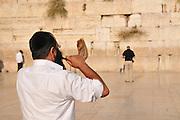 Israel, Jerusalem, Old City, Wailing Wall man blows Shofar