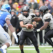 Quarterback Angel Santiago, Army, fakes hand off during the Army Black Knights Vs Air Force Falcons, College Football match at Michie Stadium, West Point. New York. Air Force won the game 23-6. West Point, New York, USA. 1st November 2014. Photo Tim Clayton