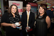 Arlene Naughton and Lorraine Lynch and Damien English TD, Minister of State at the Department of Jobs, Enterprise & Innovation at the Hurlog stand at the annual SCCUL Enterprise Awards prize giving ceremony and business expo which was hosted by NUI Galway in the Bailey Allen Hall, NUIG. Photo:Andrew Downes