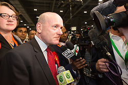 © Licensed to London News Pictures. 12/06/2015. London, UK. Labour's JOHN BIGGS speaks to the press at the Excel Centre in London after winning the Tower Hamlets Mayor election. Lutfur Rahman was removed from office for fraud and corrupt practices by an election court earlier this year and the 2014 election was rerun as a result. Photo credit : Vickie Flores/LNP