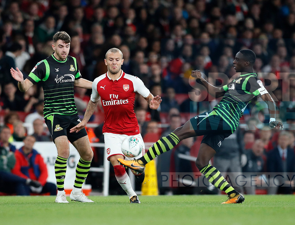 Arsenal's Jack Wilshere tussles with Rodney Kongolo of Doncaster during the Carabao cup match at the Emirates Stadium, London. Picture date 20th September 2017. Picture credit should read: David Klein/Sportimage