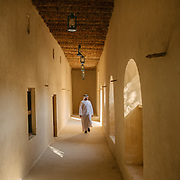 A man visits the Al Jahili Fort, one of the UAE's most historic buildings. It was erected in 1891 to defend the city and protect precious palm groves.
