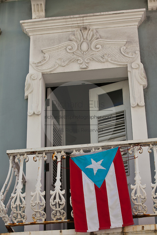 Puerto Rican flag hangs from a balcony in Old San Juan, Puerto Rico