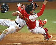 Home plate collision during USA-China baseball game during 2008 Beijing Olympics.