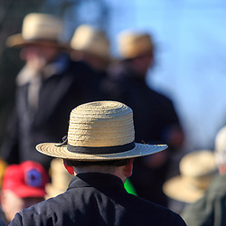 Gordonville, PA, USA / March 10, 2018: An Amish man watches for an item to be sold at auction at the annual Lancaster County Mud Sale at the Gordonville Fire Company.