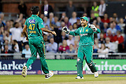 Wahab Riaz and Sarfraz Ahmed celebrate taking a wicket during the International T20 match between England and Pakistan at the Emirates, Old Trafford, Manchester, United Kingdom on 7 September 2016. Photo by Craig Galloway.